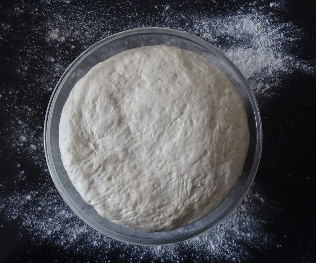 bowl of bread dough, yeast, flour, olive oil