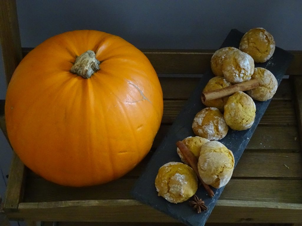 pumpkin, cookies, cinnamon sticks, wooden tray