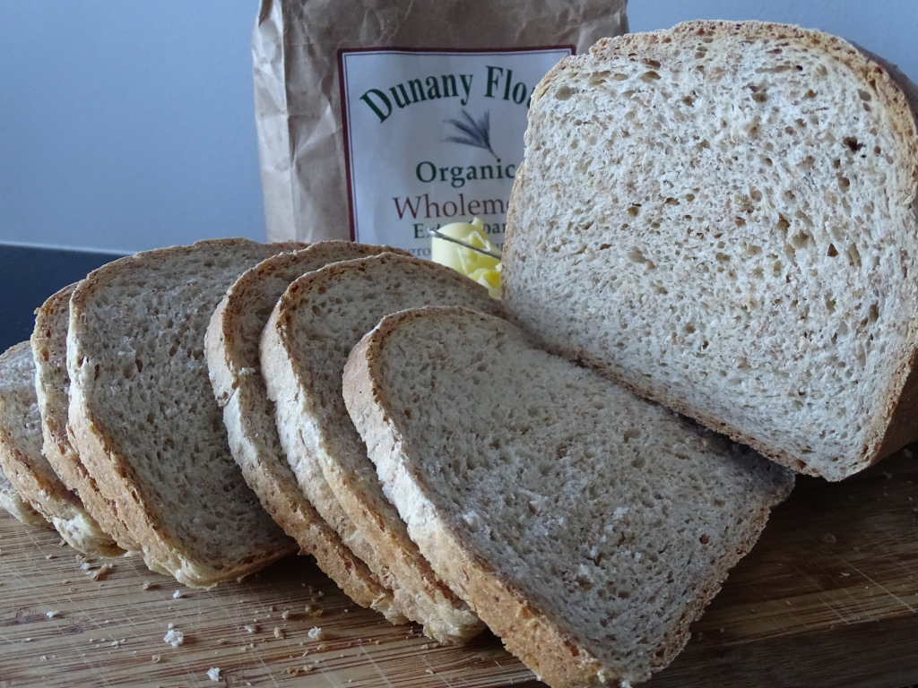 slices of wholemeal bread, bag of flour, chopping board