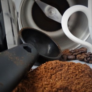 coofee grinder, coffee beans, ground coffee, cup handle