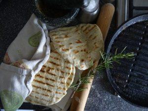 Flatbreads, griddle pan, rolling pin , rosemary sprig, pestle & morter