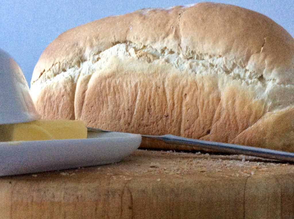 full white loaf, knife, butter, chopping board