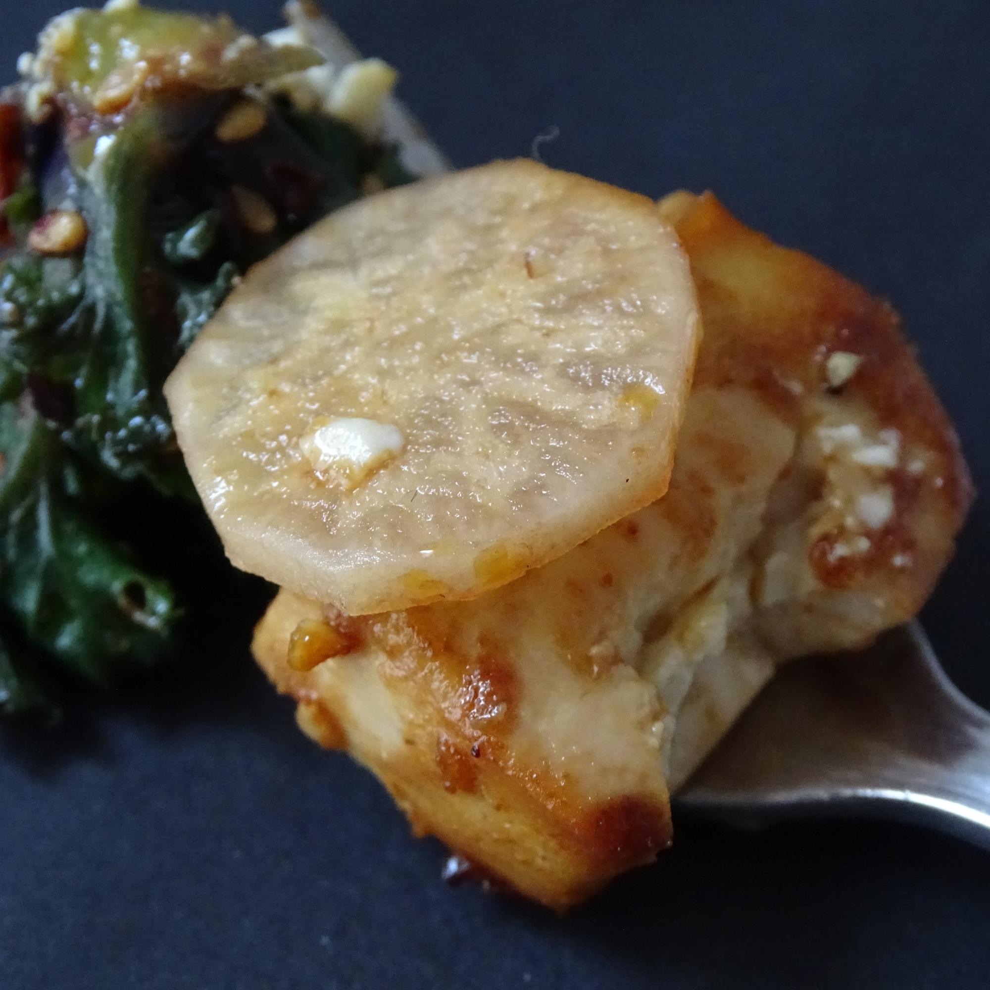 tofu, flower sprouts, radish, fork