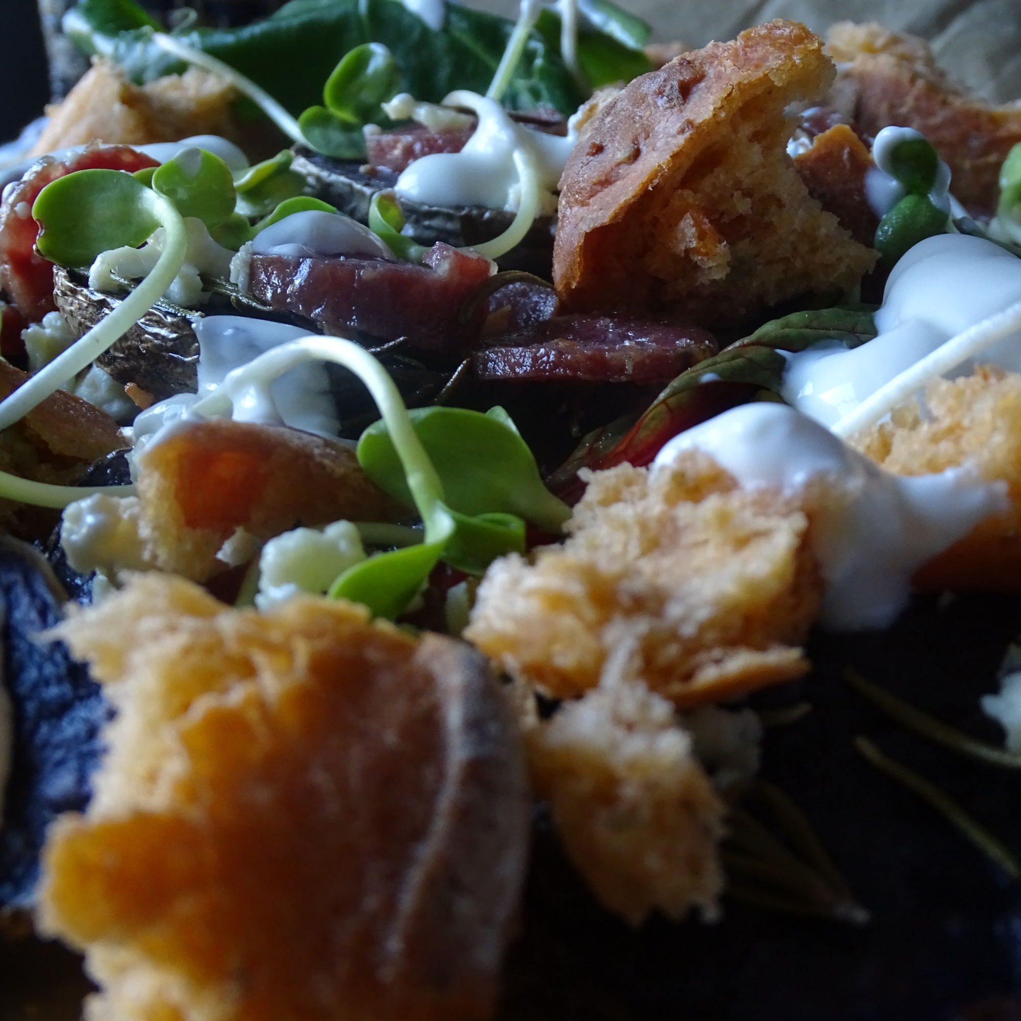 Roasted Purple Potatoes, Wooded Pig Garlic Salami, Greens, Feta & Greek Yogurt