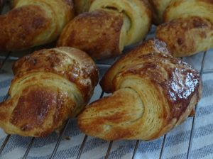 Croissants, cooling on rack