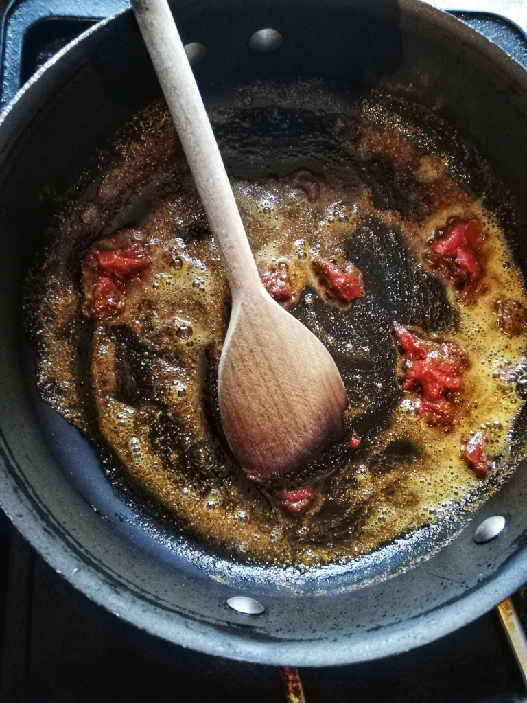 Tempering the spices for the chilli