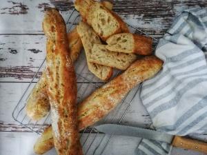 Sourdough baguettes, knife,tea towel