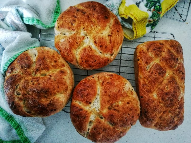 White flour & rye onion loaves,cooling rack, tea towels