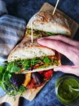 Grilled vegetable ciabatta, citrusy purslane dressing, grabbing hand