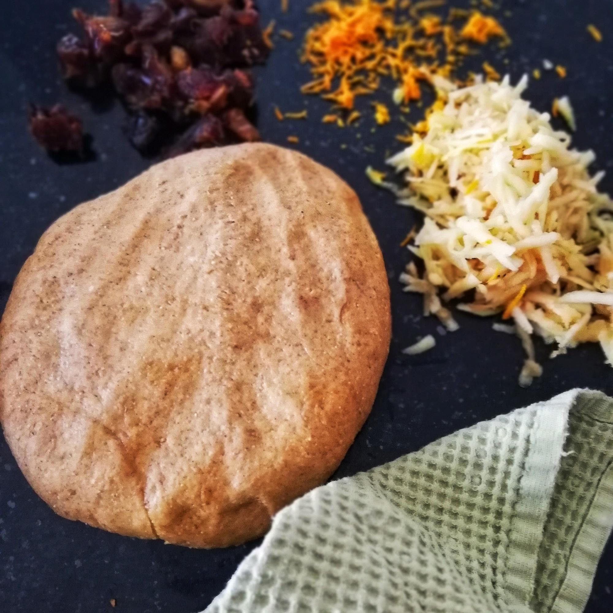 Food photography,Hot cross bun dough, shredded apple, chopped dates, orange zest