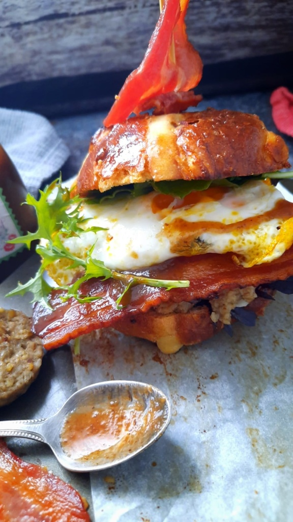Hot cross bun brunch roll, Free range egg, smoked bacon, white pudding,plum ketchup