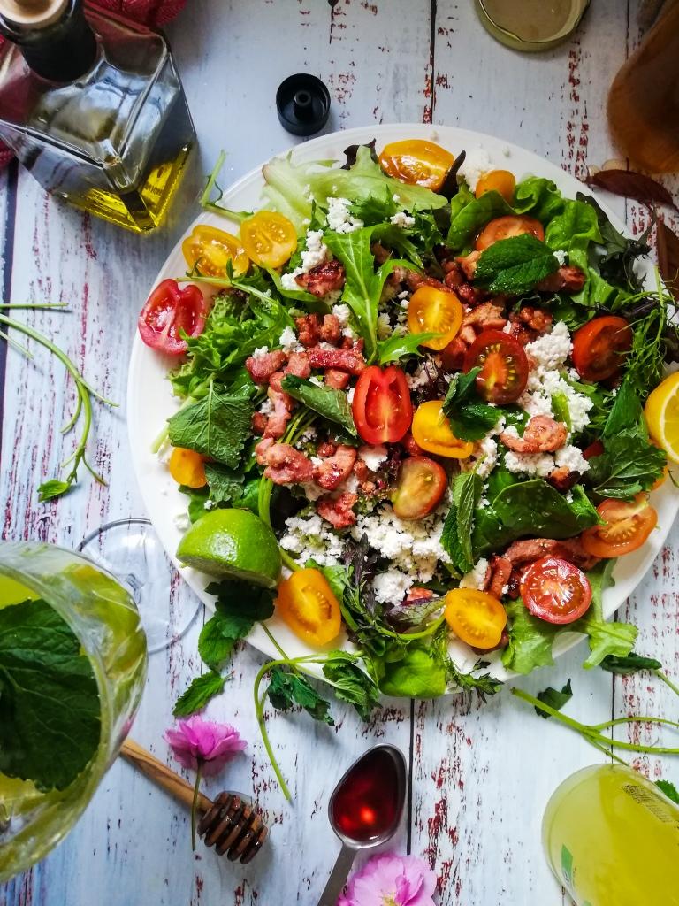 Food photography,Seasonal leaves, sheep's milk ricotta, Smoky bacon lardons, rainbow tomatoes,oil, vinegar