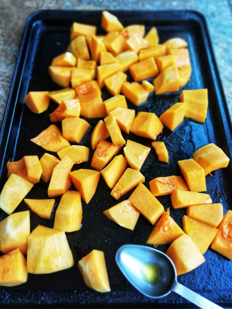 Food photography, Chopped butternut squash, baking tray, table spoon