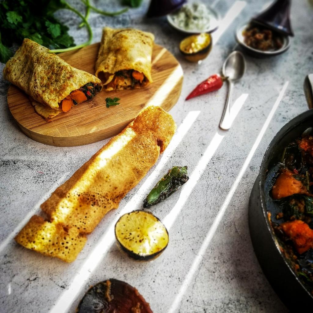 Dosa, Indian rice pancake with masala squash, lime, chilli sauce pan