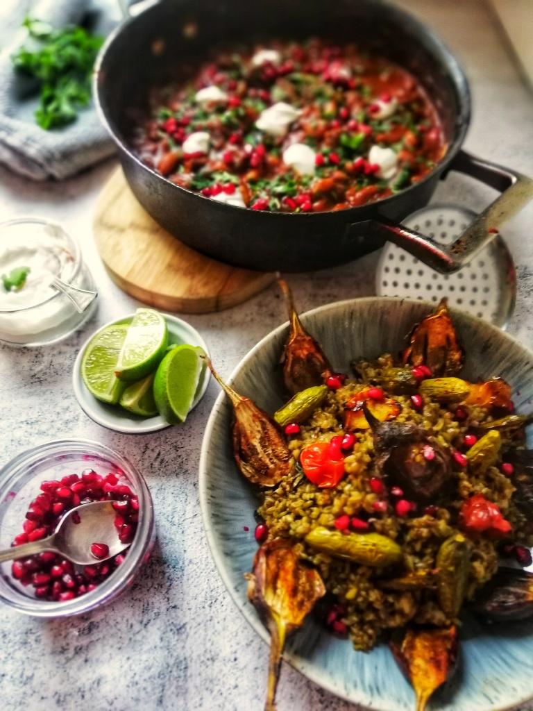 Food photography, Aubergine, chilli with roasted green wheat, sauce pan, yogurt, lime, pomegranate
