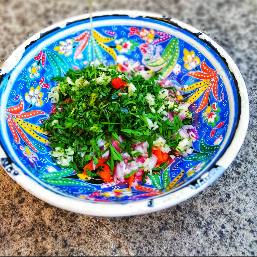 Chopped ingredients for homemade dressing in colourful bowl