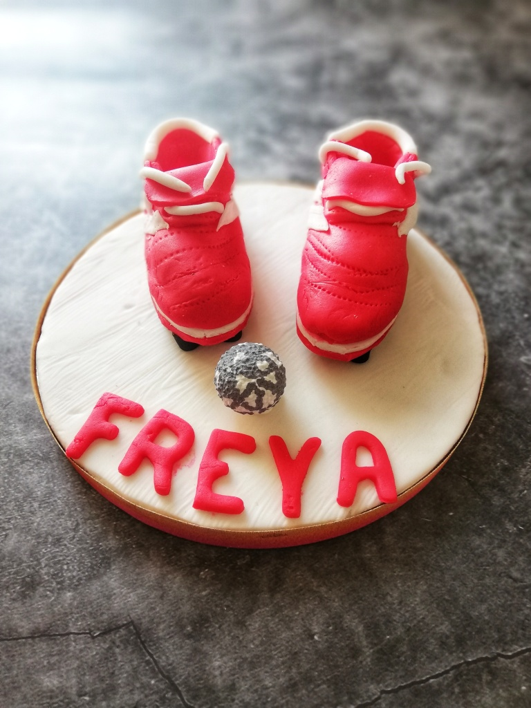 Food photography, Small sugar icing football boots, with name Freya