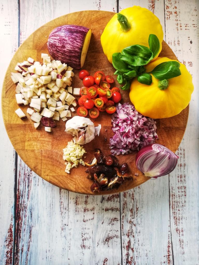 Image, ingredients for stuffed Pattypan squash on chopping block