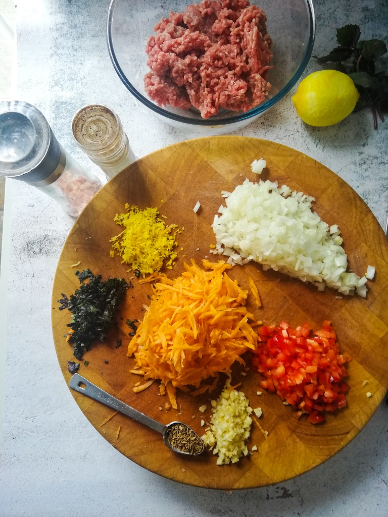 ImageI,ingredients for lamb meatballs, chopping board